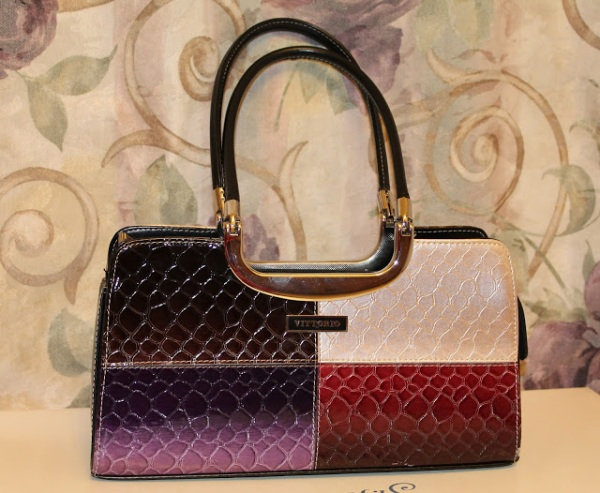 """This Vittorio """"Italy"""" Handbag is my first designer bag. My husband purchase this on our first trip to Las Vegas. I'm so happy when he hand this to me, I was surprise and overwhelmed. He is right """"happy wife happy life"""".. lol"""