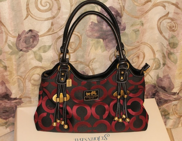 My Coach Kristin Signature Top Bag Red/Black  I used it almost everyday. It has multifunction pockets that fits all my belongings.