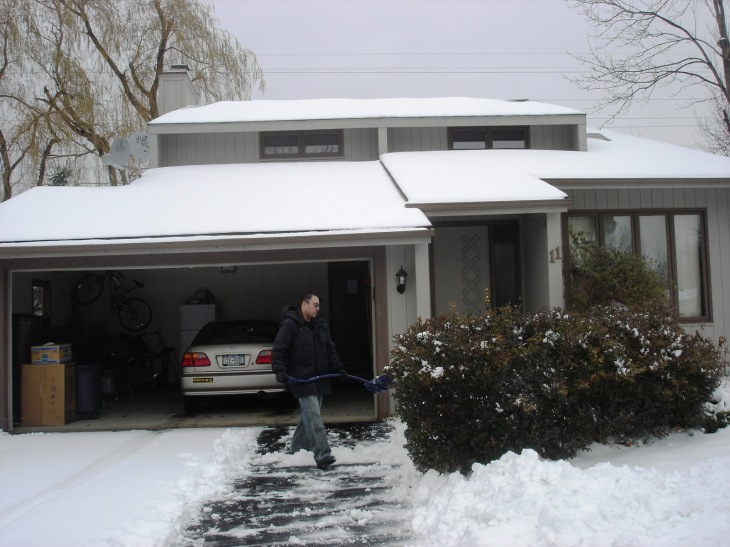 Winter Time and my husband is shoveling the 5 inches of snow
